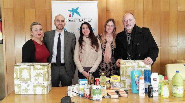 La obra social la caixa colabora con c ritas entregando for Seguro hogar la caixa